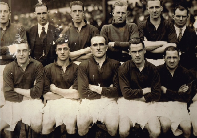In this Arsenal team photo David Jack is wearing a suit as he was injured. On the end of the Albert chain seen in this photo was his winners medal from the 1923 FA Cup Final which went everywhere with him