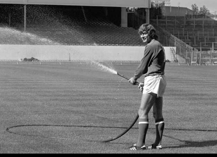 Pat helping out by watering the Highbury pitch