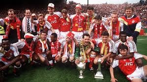 Paul celebrates with the rest of the 1990-91 title winning squad