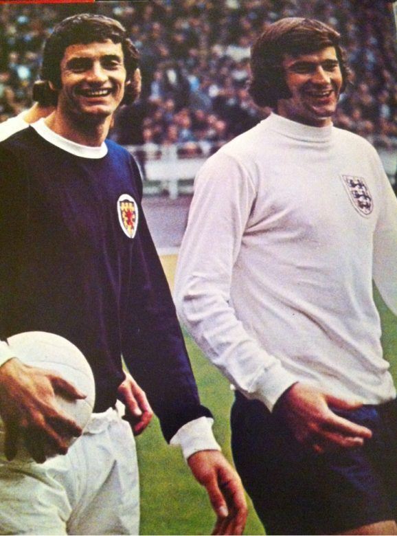 Club team mates Frank McLintock and Peter Storey are foes for England v Scotland