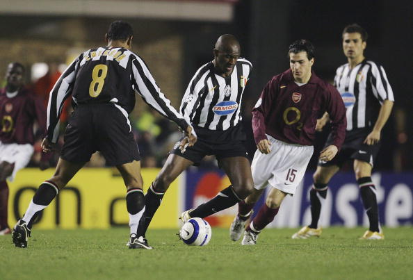 Vieira in the black and white stripes of Juventus with Arsenal's Cesc Fabregas