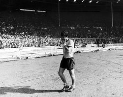 Malcolm walks off the Wembley pitch after losing a third major Cup Final