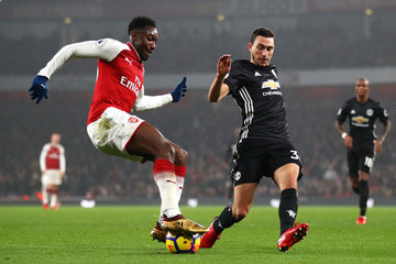 Damian in action against Arsenal, closing down Danny Welbeck