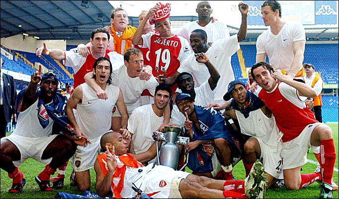 The Invincibles celebrate winning the title at White Hart Lane in 2004