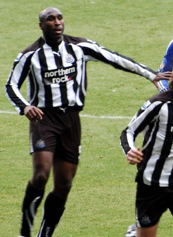 Sol wearing the black and white shirt of Newcastle United