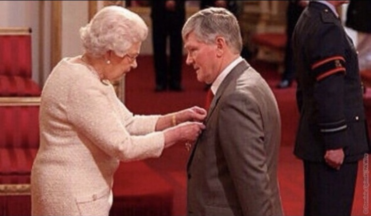 Pat with Her Majesty receiving yet another medal!