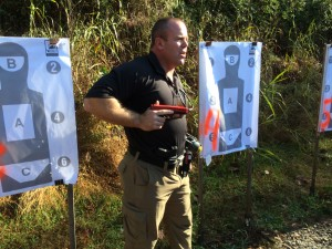 """Greg Ellifritz, the brains behind Active Response Training, demonstrates the """"#2"""" position with a SIRT gun."""