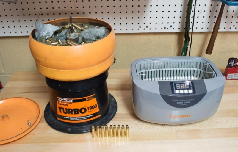 However you do it, with a dry tumbler or liquid method like the Lyman ultrasonic cleaner on the right, be sure to clean the loose dirt from your brass before reloading. It doesn't have to be shiny, just clean.