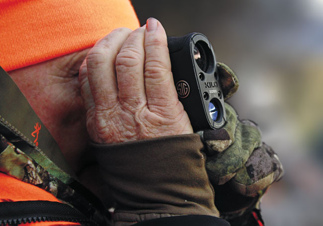 SIG Sauer's Kilo2000 7x25mm is one of the newer compact rangefinders. The author picked a spot overlooking a Montana hayfield where a buck appeared, so he was busily ranging — and memorizing — the distance to prominent rocks and trees.