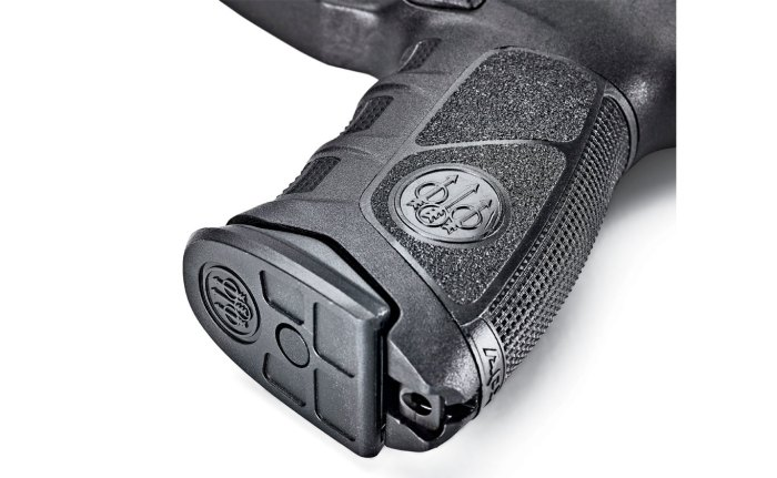 The magazine basepads are easy to grasp, and a lanyard attachment point is integral to the steel backstrap retaining rod.