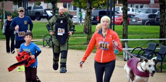 Dave Rhoden runs the 5K in a bombsuit.
