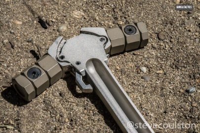 Avalanche charging handle underside on dirt