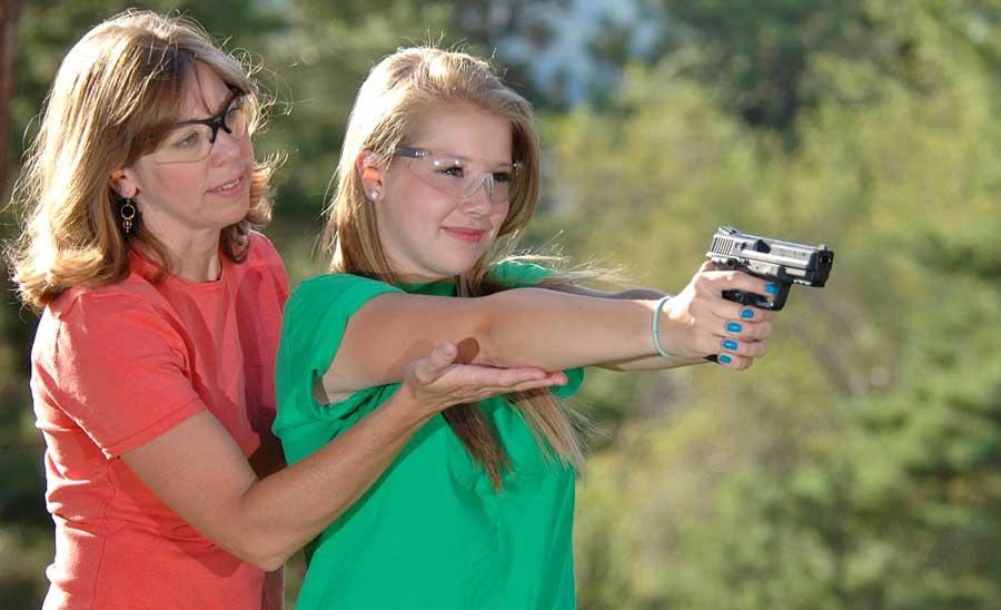 mom daughter pistol shoot