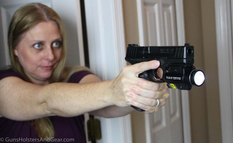 flashlight mounted on rifle