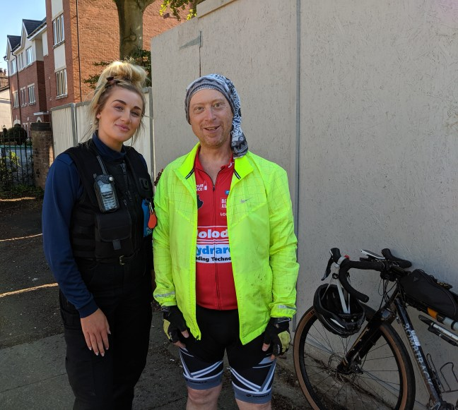Cyclist with a Police Community Support Officer