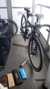 Bike in workstand and tools on narrow balcony