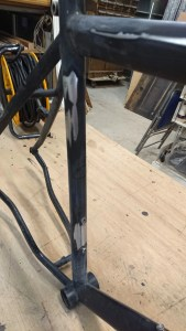 Bicycle frame showing bare steel where paint has been sanded away