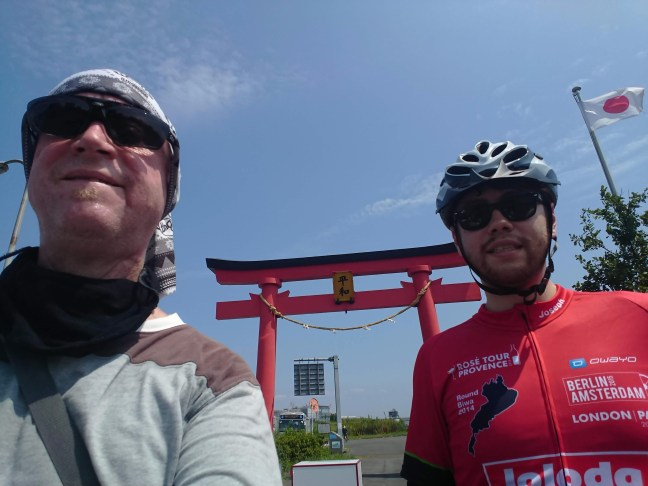 Two cyclists in front of Haneda Peace Shrine