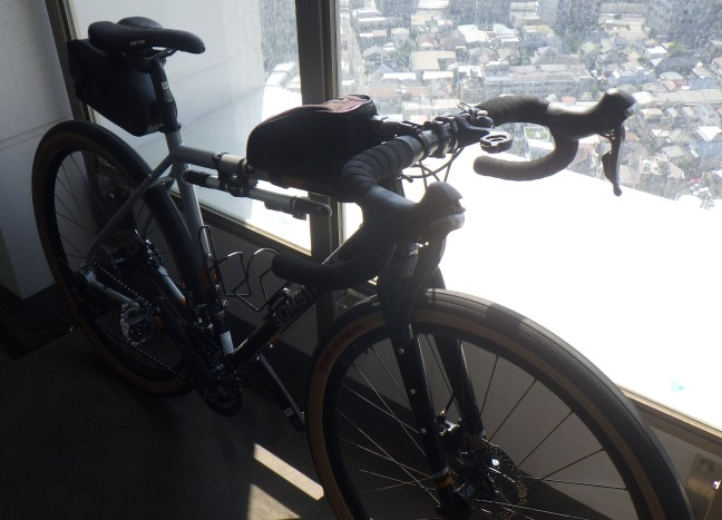Bicycle on a balcony overlooking the city