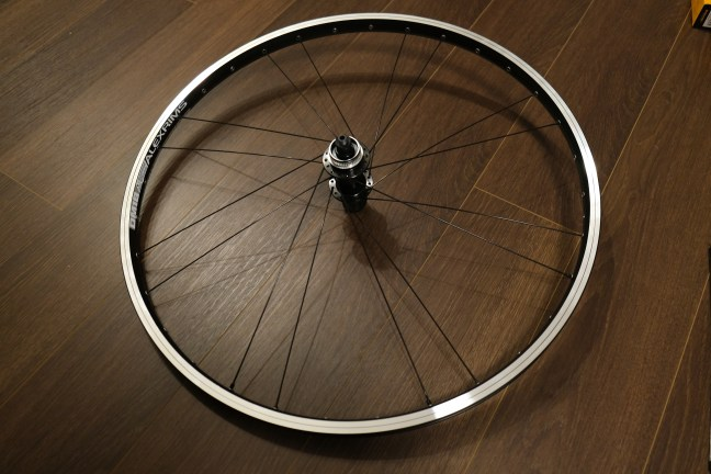 Bicycle rim and hub with first 16 spokes inserted