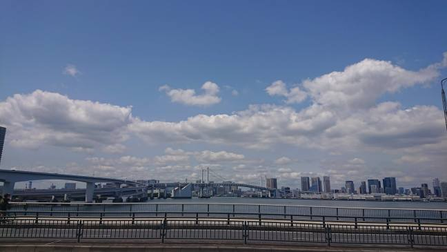 Rainbow Bridge under blue skies and white clouds