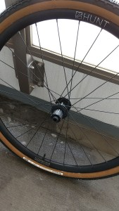 Bicycle tire leaning against balcony railing