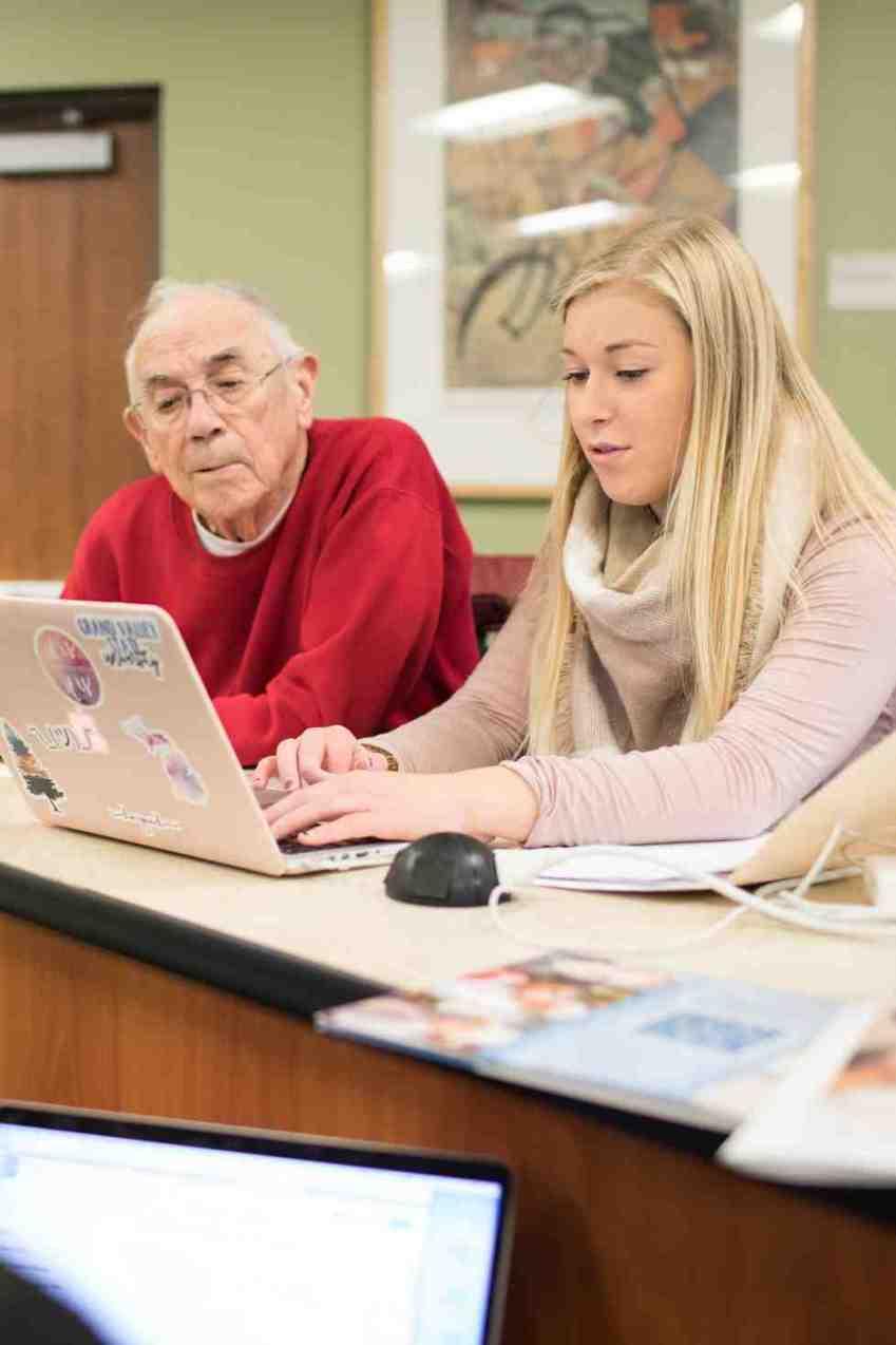 woman and older man at computer