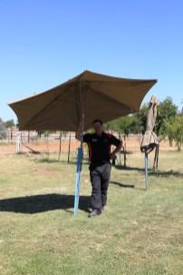 Kerry Phelan showcasing one of the new umbrellas at Illabo Motorsport Park Gasworks Volunteers Nicholas Pyers and Joe Belling raising the NSW State Flag at Illabo Motorsport Park -- Illabo Motorsport Park March 10, 2021