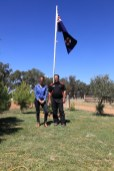 Steph Cooke MP and Kerry Phelan standing under the NSW State Flag -- Illabo Motorsport Park March 10, 2021