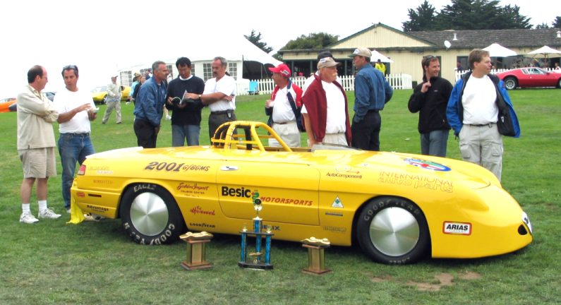 The crew of Bonnie, the world's fastest Alfa, gathers on the lawn at Concorso Italiano in 2005.  This car has run just a hair under 233 mph at Bonneville.