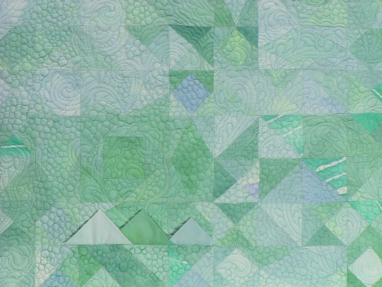 Squares and triangles of a variety of values in the mint green and sky blue family