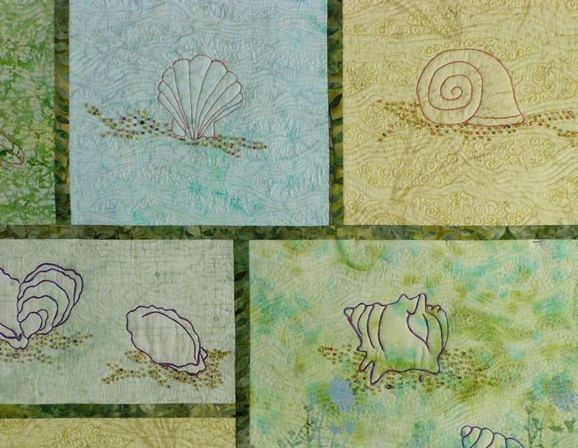 Detail from Beach Stroll zeroing in on the a few shells, the bias strip grid and beadwork
