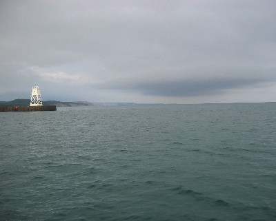 Photo: Clouds looming as we approach the entrance of Grand Marais, Michigan. Credit: L. Borre.