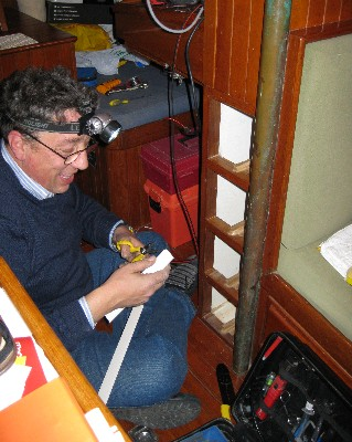 Photo: Libero at work rewiring our navigation station on Gyatso. Credit: Lisa Borre.