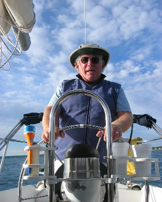 Photo: David R. Barker at the helm on the second year of our Great Lakes trip. Credit: L. Borre.