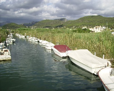 Photo: Local boats tied up along a small river in Andraitx, Mallorca, Balearic Islands, Spain. Credit: Lisa Borre.