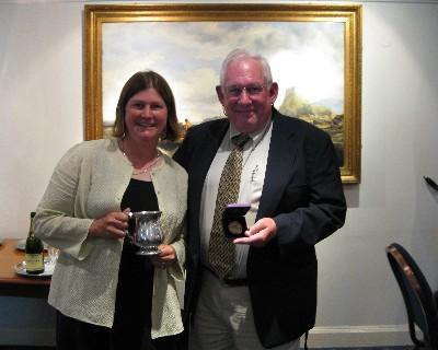 Photo: David Barker and Lisa Borre receive award from Ocean Cruising Club.