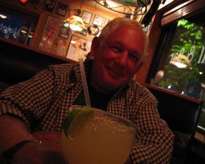 Photo: David celebrates end of Great Lakes trip. Credit: L. Borre.