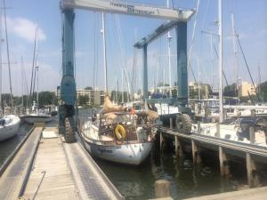 Gyatso being hauled out at Port Annapolis Marina on 27 May 2014, bringing an end to our extended voyage. Photo by Lisa Borre.