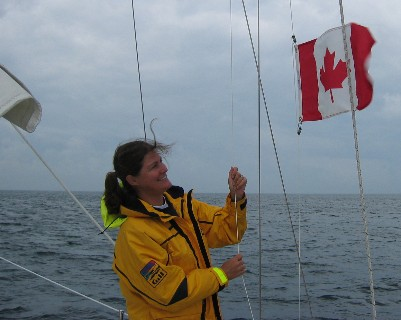 Photo: Hoisting the Canadian courtesy flag at the starboard spreader. Credit: D.R. Barker.