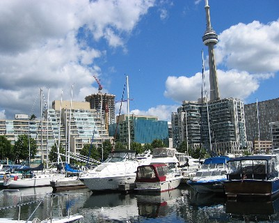 Photo: About Time (on left) at dock in downtown Toronto with the CN Tower in the background. Credit: L. Borre.