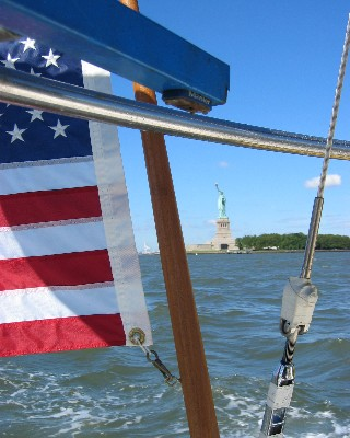 Photo: Statue of Liberty from the stern of s/v About Time. Credit: L. Borre.