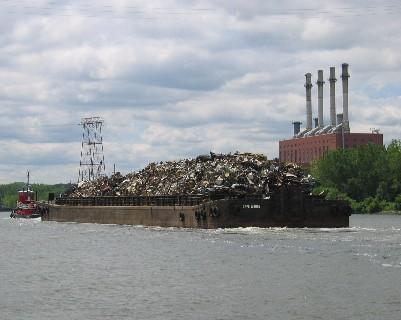 Photo: Trash barge, Hudson River, NY. Credit: L. Borre.
