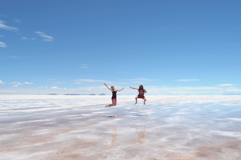 2-salar-de-uyuni-flooded-wet-season-woman-man-jump