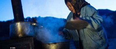 Picture of Roma woman cooking