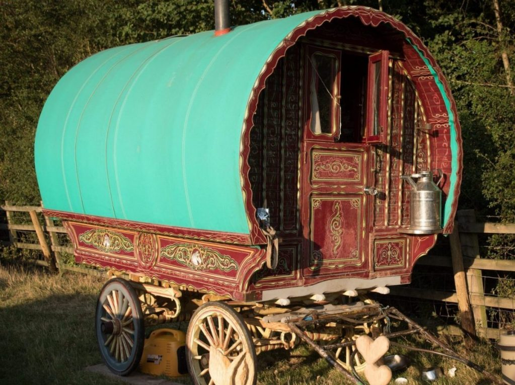Picture of traditional Gypsy wagon next to a fence