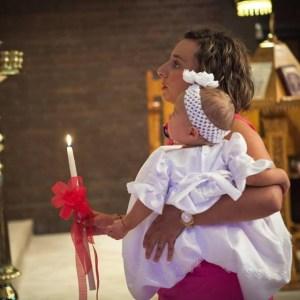 Greek Orthodox sacraments in her home church