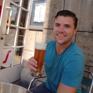 Grant drinking a German beer in Stuttgart