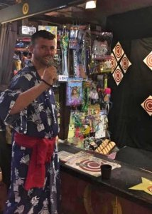 Grant playing games and wearing traditional robe at a Tokyo Onsen