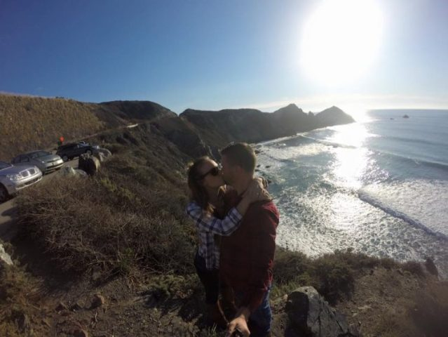 Kissing next to the PCH near Big Sur California